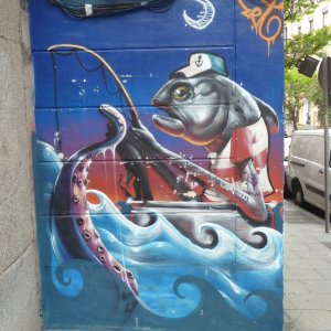 street art Madrid poisson qui pêche quartier Malasana